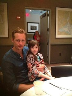 """Alexander Skarsgård and Onata Aprile in NYC for the premiere of """"What Maisie Knew"""" (May 2, 2013)"""