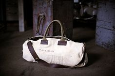 WWII Salvaged Canvas Duffel. I love stuff that has a story to it. Very cool piece to own. x
