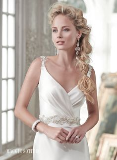 Montana wedding dress by Maggie Sottero   Refined elegance is found in this decadent Orlando satin sheath wedding dress with a deep V-neckline and daring, plunging back. Swarovski crystals adorn the waist and dust the shoulders. Finished with zipper closure.
