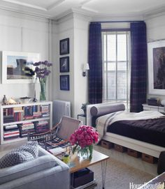 "To keep order in his small Brooklyn studio apartment, window designer Zach Motl came up with an innovative storage solution. ""Those baskets under the bed are for electrical supplies and a hammer and glue gun,"" he says. ""It's a toolbox, but spread out."" Large photos by Alex O'Neill; small trio by Irving Penn. Parsons bookshelf, West Elm."