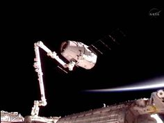 The space station's robotic arm has grappled SpaceX's Dragon spacecraft!