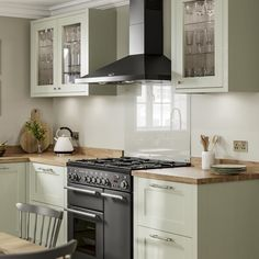 Pale enough to work as a neutral, the sage green tone of these sturdy, 20mm-thick doors makes a great choice for those that want a subtle style with plenty of country character. Choose from a wide variety of cupboards, such as larder units, which can keep cooling devices hidden from view to help maintain an uninterrupted design. Two Tone Kitchen Cabinets, Green Cabinets, Cupboards, Kitchen Themes, Kitchen Decor, Kitchen Ideas, Country Kitchen, New Kitchen, Kitchen Interior