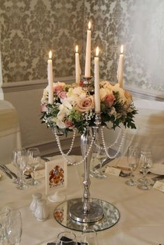 In the Windsor Suite Regency Candelabras draped with strings of pearls and…