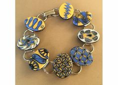 Zentangle inspired art bracelet of yellow and blue - hand drawn designs…