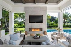 718 Buttonbush Lane, Naples, FL 34108 :: The perfect poolside outdoor living room with built in fireplace and television Living Pool, Outdoor Living Rooms, Outside Living, Outdoor Spaces, Living Spaces, Luxury Living Rooms, Outdoor Deck Decorating, Outdoor Decor, Floor To Ceiling Windows