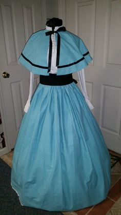 Civil War Teal Striped Pattern Skirt with Black Sash (blouse not included)  The Teal Striped Pattern Skirt  It is washable which is great for reenacting. Draw String waist band 70 ribbon one size fits all. 120 inches around bottom It can be Hemmed as long as 41 from top of the skirt to the bottom please give me the length you need and I will hem it for you.  Sash  It is washable The length is 121 inches or 3 1/3 yards long by 8 1/2 inches wide The Sash Can also be made to fit whatever size…