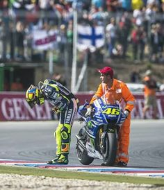 Valentino Rossi taking a bow in front of his fans at Brno after finishing 3rd 2014