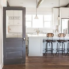 A shot of the kitchen and pantry door at our latest home. Photo courtesy of the talented A shot of the kitchen and pantry door at our latest home. Photo courtesy of the talented Kitchen Doors, Kitchen Redo, Kitchen Remodel, Kitchen Design, Pantry Doors, Glass Kitchen, Swinging Doors Kitchen, Rustic Pantry Door, Pantry Sign