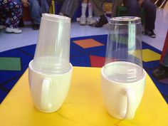 Evaporation Experiment: two cups with water, heat one and put clear plastic cups on top to see evaporation.