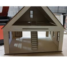 Made in the USA from Baltic birch plywood garage/workshop kit in scale. Includes 16 x 7 inch working garage door, working windows and door. Dollhouse Kits, Dollhouse Miniatures, Car Garage, Garage Doors, Baltic Birch Plywood, Garage Workshop, Windows And Doors, Gazebo, Scale