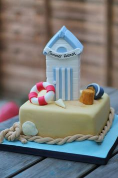 Beach hut seaside themed cake