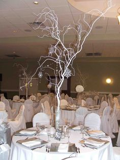 Easy Centerpiece Using Branches Spray Painted White Battery Powered Snowflake Lights Clear Crystals And Fake Snow