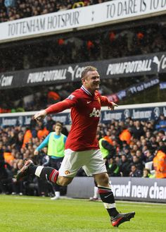 An experienced Wayne Rooney celebrates giving Manchester United a 1:0 lead just before the half time after headering past Brad Friedel.