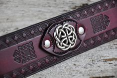 Celtic Reign Leather Cuff. $75.00, via Etsy.  Excellent use of concho w/o having the metal back against the skin.  A must do with my own design.