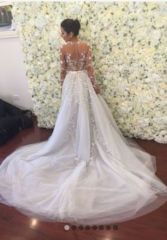 Custom designed Paolo Sebastian wedding gown. Comes with long veil, detachable full skirt and under garment. Please note the undergarment was NOT worn on the day of the wedding. After wearing my weddi