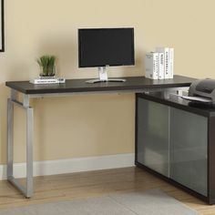 Features:  -Material: Wood.  -L shaped.  -Desk return is not reversible.  Desk Type: -Writing desk.  Base Finish: -Silver.  Top Material: -Manufactured Wood.  Base Material: -Metal.  Hardware Material