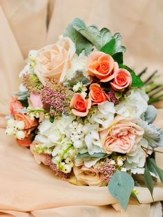 Pale peach, mint, and white wedding bouquet. Peach spray roses, Garden Spirit roses, eucalyptus, snowberries, blush rice flower, mint leaves. | The Petal Pusher Florist - Flowers - Gifts - Events