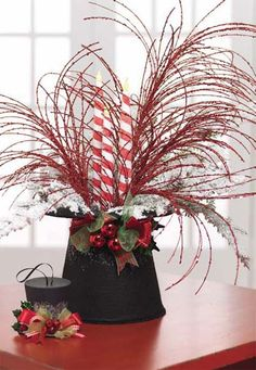 red and white Christmas Floral Picks and Sprays | RAZ Upturned Black Top Hat Christmas Decoration