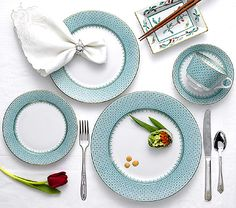 Mottahedeh Green Lace 5-Piece Place Setting: The very popular Bridal pattern Blue Lace, is getting a new look, GREEN. This versatile pattern with its delicate border was inspired by Ch'ing Dynasty (1644 -1911) porcelain from China. Highlighted by bands of 22K gold, this elegant design makes a stunning presentation and coordinates beautifully with other services. Sizes and prices shown below.