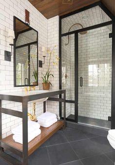 White tile, glass with rod iron trim. Bathroom