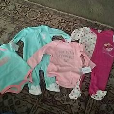 Baby hotel clothes all nwt Carters 3 mo mint green with orangeish color says too cute, 3 no mint green  with white dots and  bunny feet Carters pj's that zip in front, Carters 6 long sleeve onesie pink says seriously adorable in silver and a cute pink and polka dot PJs that button in front 3-6 month Baby works brand. All bnwt never used. Bought for a friend but her baby was to big so bought other stuff. Other