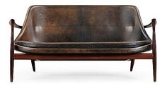 An Ib Kofod Larsen Elisabeth palisander and black leather sofa, Christensen & Larsen, Denmark 1950-60s. Length ca 144 cm.. - The Spring Contemporary, Stockholm 573 – Bukowskis