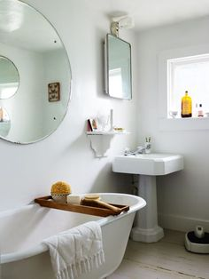 white bathroom . round mirror . claw foot tub ............. (via Interior inspirations)