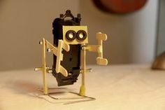 How to make a walking robot with moving arms Ice cream stick biped Make A Robot, Diy Robot, Robots For Kids, Science For Kids, Stem Projects, Science Fair Projects, School Projects, Projects For Kids, Diy For Kids