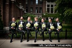 Funny groomsmen photo with the bridal and bridesmaid bouquets - do it! ~ E.A