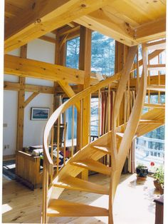 Timber framed home with spiral staircase.