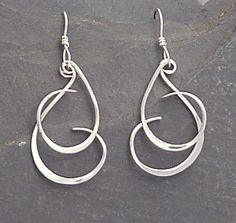 Welcome! We appreciate your interest in our jewelry. Please click on the Shipping & Policies tab below to see our current shipping schedule. Thanks. . Handmade sterling silver forged and fun dangle earrings we call Curly Q. These sterling silver Curly Q earrings are fun to wear. Each individual curl moves independent of the other, giving the earrings lots of interest and motion. (wish we had video so you could see it :-) ) The sterling wire on each curl is planished with a hammer in two d...