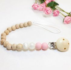 Natural wood and silicone soother or toy clip teether. Handmade in Canada. Baby Accessories, Natural Wood, Pearl Necklace, Canada, Toy, Jewels, Handmade, Fashion, String Of Pearls