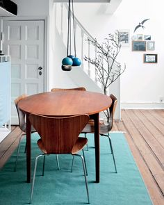 Scandinavia's favorite accent color? Clearly, it's blue — a bright blue that stands out brilliantly against the black and white and wood, like in this colorful Copenhagen home. Here's coming this trend comes stateside (and soon). Read more at ELLEDecor.com: You Could Own A Piece Of Oprah's Personal Collection   - ELLEDecor.com