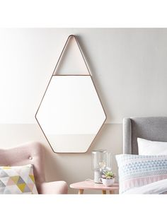 Ideal Home Hexagonal Wall Mirror – Increasing the sense of depth and light to your space, this stunning wall mirror by Ideal Home takes influence from the season's key themes to add a unique statement to contemporary rooms. Measuring 68 x 112 cm, it boasts an eye-catching hexagon design, with a copper-toned frame that continues on past the top corners of the reflective surface to create a triangular hanging point. This gives the whole mirror an extra burst of personality that's perfect...