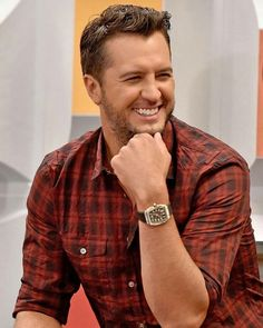 I'm thinkin' this may have been a photo shoot for Luke Bryan---how much cheezier  could a grin get?