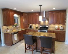 l-shaped kitchen layout with green and white.   kitchen design