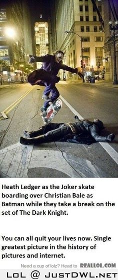 Joker skate boarding over batman