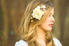 Wedding hairstyle with fabulous  pearls and flowers accessories, great for rustic style weddings.