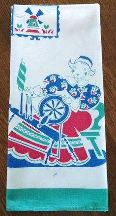 Vintage Dish Tea Towel, color printed with a Dutch Girl & Spinning Wheel