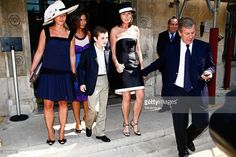 Cecilia Attias (4th from L) and her son Louis Sarkozy (C) and Richard Attias (R) leave the town hall of Paris 7th after the civil wedding of Jeanne-Marie Martin and Gurvan Rallon on May 10, 2008 in Paris, France.
