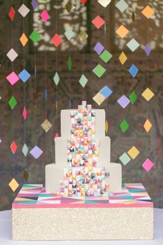 Colorful geometric wedding cake - such an adorable cake display #wedding…