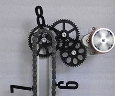 Form meets mechanical function with these moving gears chain clocks. The perfect display piece for any engineer's home or office, these brilliantly designed chain clocks will accurately display the time using a variety of basic and exposed gear mechanisms.