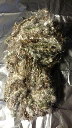 "My gorgeous lockspun yarn, made with mohair locks, silk and sparkle. I call it ""Absinthe Smoke""."