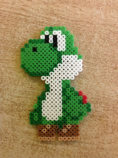 Hama Beads Yoshi Source by christinsteinfe You may believe that the history of handcrafted beaded je Hama Beads Mario, Diy Perler Beads, Hamma Beads 3d, Fuse Beads, Pearler Beads, Pikachu Hama Beads, Hamma Beads Ideas, Melty Bead Patterns, Pearler Bead Patterns