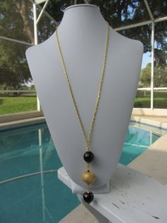 Faceted Black Onyx With A Gold Plated Bead From by JKCustomDesigns