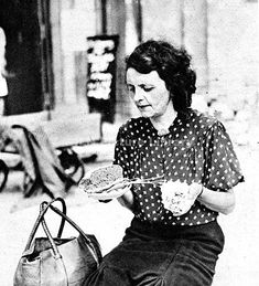 A German woman in Berlin holding her daily ration: a small piece of bread, a few carrots and some dehydrated potatoes, August 1945. This picture was taken shortly after the end of the Second World War in Europe and reflects widespread shortages across the continent.