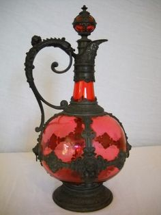 Antique decanter of ruby red glass set in intricate metalwork (1700's-1800's). I love this!