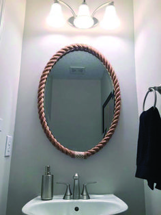 Rope Mirror Frame My powder room had a boring oval mirror that was glued onto the wall. Since I couldn't replace it (easily), I decided to frame it with some rope to add texture… Rope Mirror, Round Wall Mirror, Diy Mirror, Mirror Ideas, Rope Frame, Mirror Vanity, Mirror Bedroom, Bathroom Mirrors, Mirror Mirror
