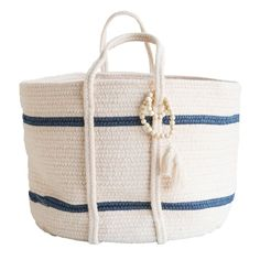 Newport Stripe Basket exclusive to McGee & Co. Woven with beads, tassels, and nautical stripes.