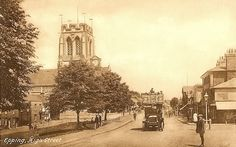 Essex, Epping Church and High Street c1930's - showing an early open top bus.